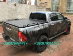 Body Cover Toyota Hilux. Cover Of A Pickup Truck. Three-Kry